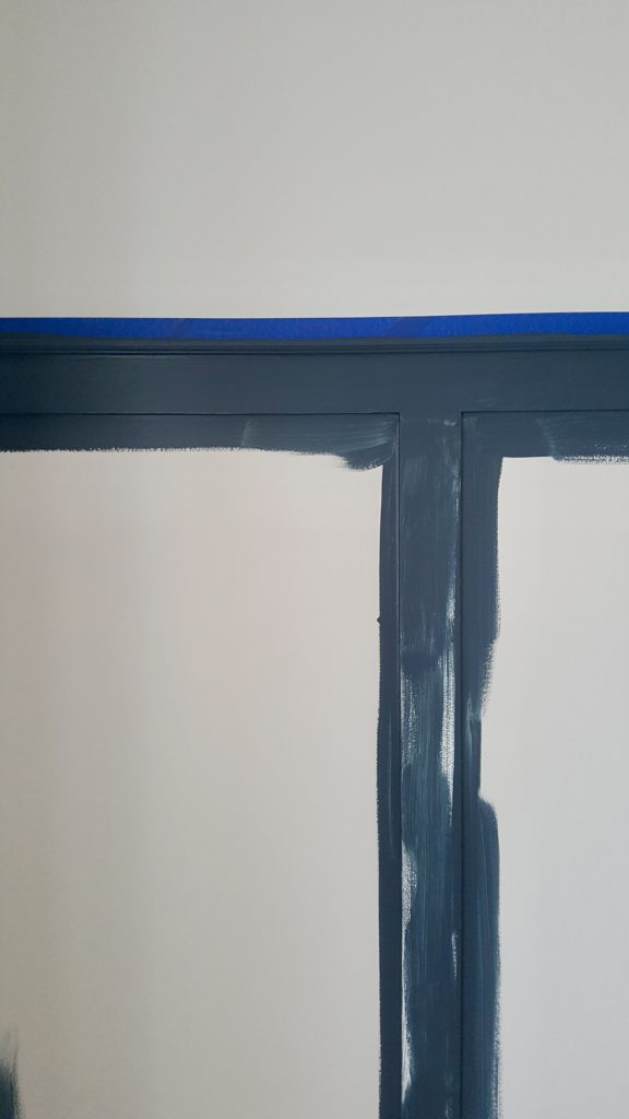 Bold Dark Blue Paint Board and Batten In The Nursery
